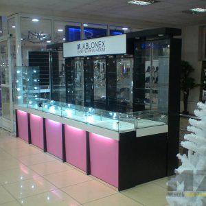 Торговый прилавок со стеклянными витринами и подсветкой
